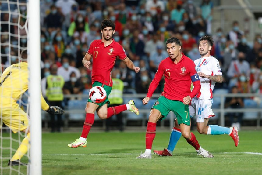 Portugal's Cristiano Ronaldo scores their fifth goal to complete his hat-trick, on Oct 12, 2021.