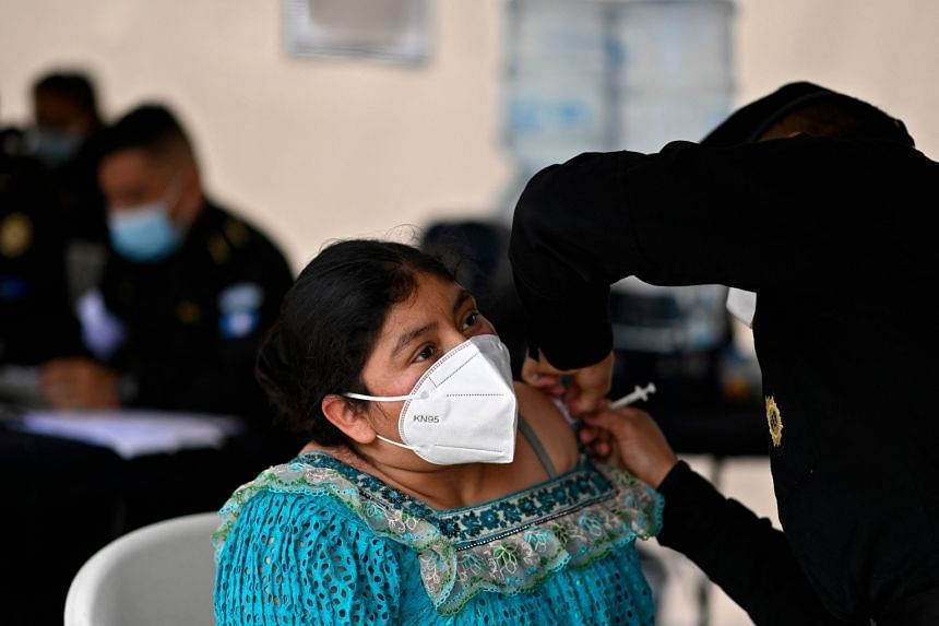 A woman receiving a dose of AstraZeneca's Covid-19 vaccine in Guatemala City on Aug 25, 2021.