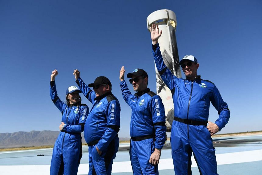 (From left) New Shepard NS-18 mission crew members Ms Audrey Powers, Mr William Shatner, Mr Chris Boshuizen and Mr Glen de Vries at the New Shepard rocket landing pad on Oct 13, 2021.