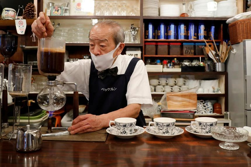 Mr Shizuo Mori, the owner of Heckeln coffee shop brews coffee at his shop in Tokyo on Oct 8, 2021.