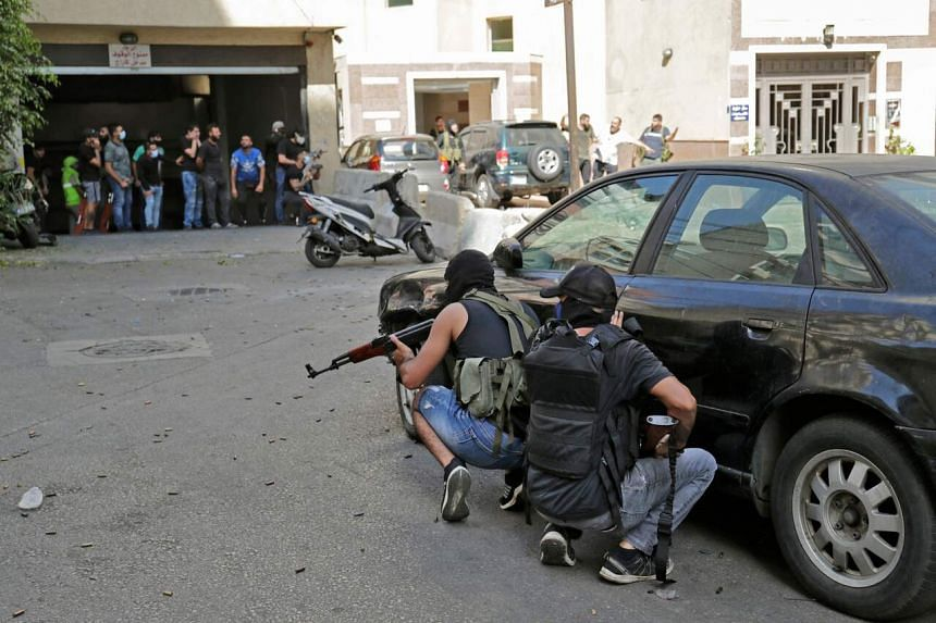 Shi'ite fighters taking cover during clashes in Beirut, Lebanon, on Oct 14, 2021.