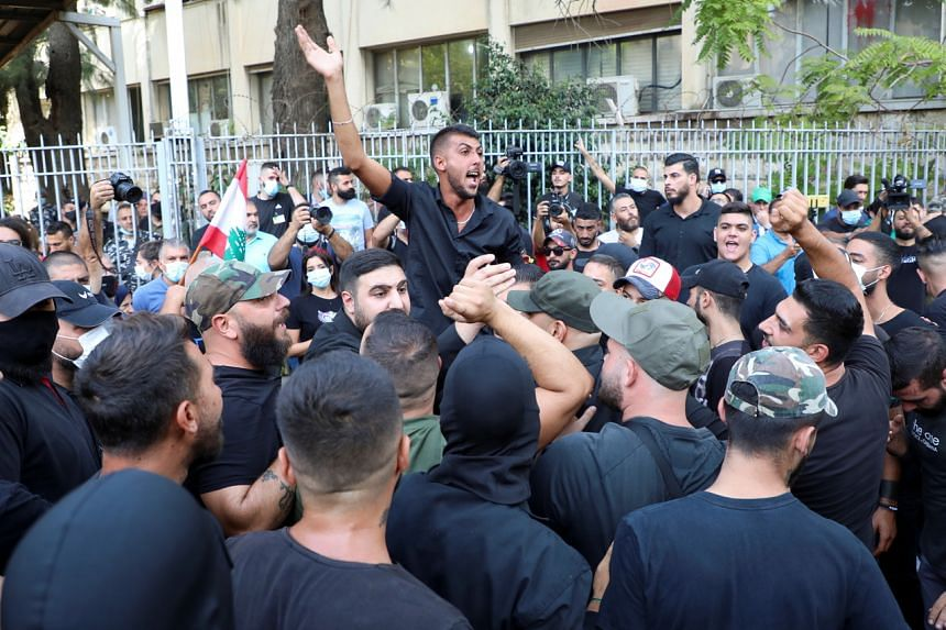 Supporters of Lebanese Shi'ite group Hizbollah and its allies taking part in a protest against judge Tarek Bitar near the Justice Palaces in Beirut, Lebanon, on Oct 14, 2021.