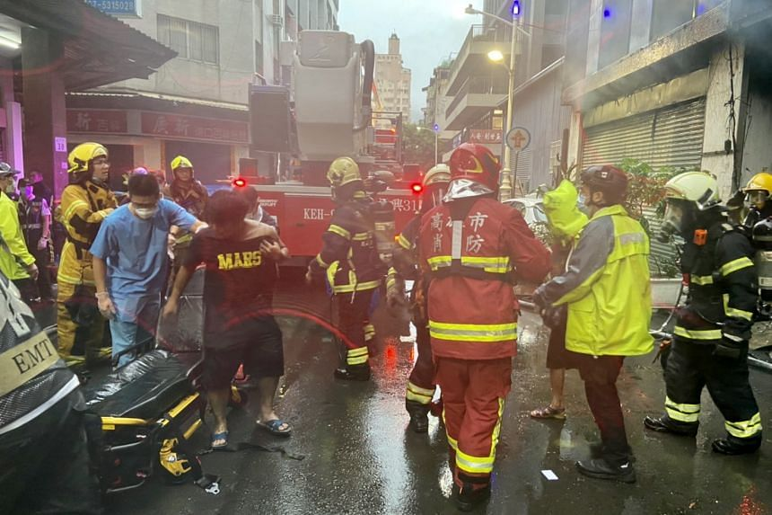 Firefighters and rescuers assisting survivors in the aftermath of the fire, in Kaohsiung, Taiwan, on Oct 14, 2021.