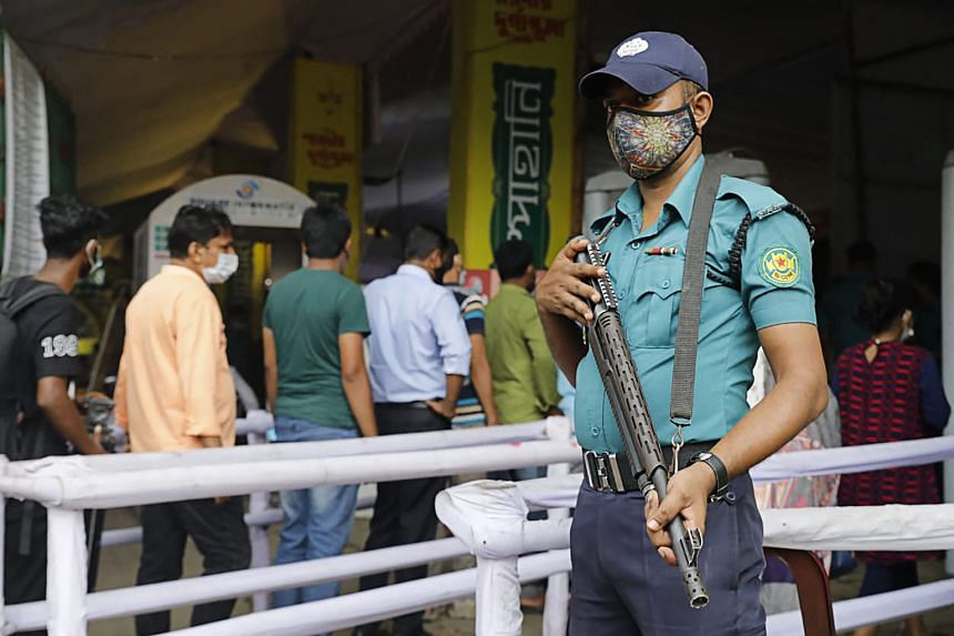 A police personnel stands guard at the Dhakeshwari temple in Dhaka on Oct 14, 2021.