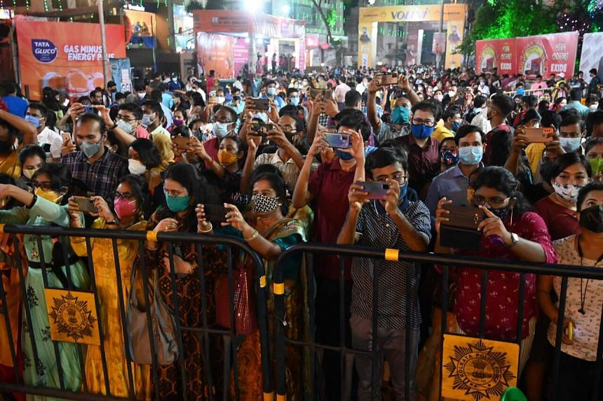 People at a makeshift place of worship of the Goddess Durga during the Durga Puja festival in Kolkata on Oct 12, 2021.