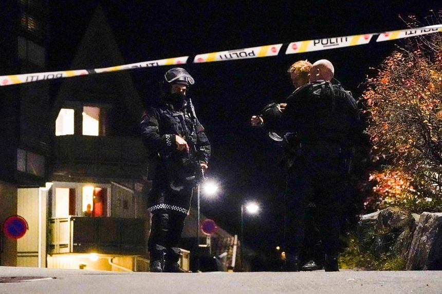 Police officers investigate after several people were killed and others injured in an attack in Kongsberg, Norway, on Oct 13, 2021.