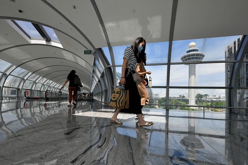 Visitors on the link bridge between Changi Airport Terminal 3 and Jewel Changi Airport on Sept 1, 2021.
