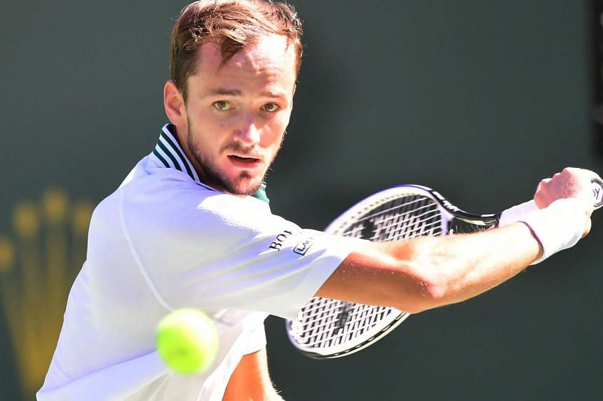 Danil Medvedev eyes a backhand return to Grigor Dimitrov in their Round of 16 match at the Indian Wells tennis tournament on Oct 13, 2021.