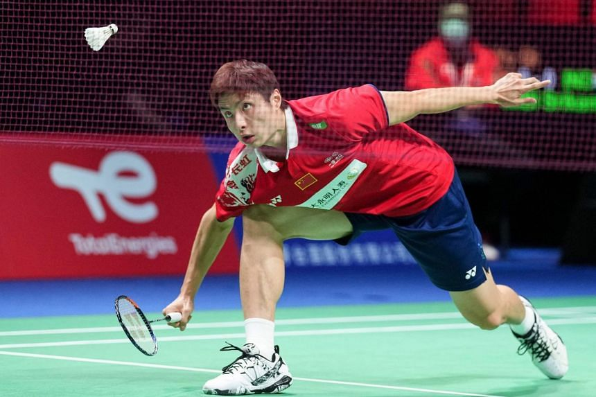 China's Shi Yuqi plays a net shot in his first singles match against Srikanth Kidambi of India.