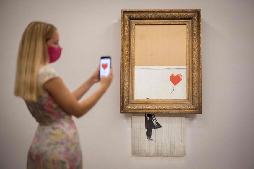 """The artwork, then-titled """"Girl with Balloon"""", was sucked into a shredder as the hammer fell at an October 2018 auction in London."""
