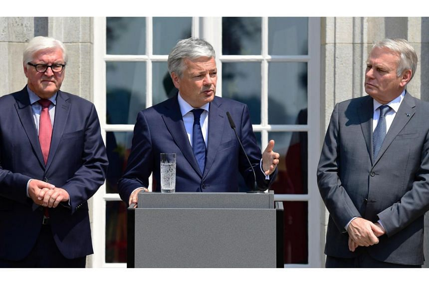 Belgium's Foreign minister Didier Reynders (centre), Germany's Foreign minister Frank-Walter Steinmeier (left) and France's Foreign minister Jean-Marc Ayrault at a press conference after talks at the Villa Borsig in Berlin on June 25, 2016.