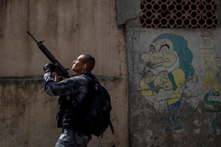 A member of the military police patrols during an operation in the Rocinha favela in Rio de Janeiro, Brazil on Jan 25, 2018.