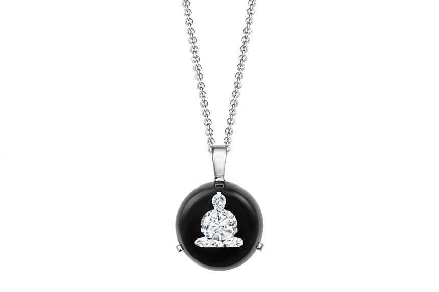 Germany: Buddha diamond set in glass pendant in 18K white gold, $7,008, by Buddha Diamonds.