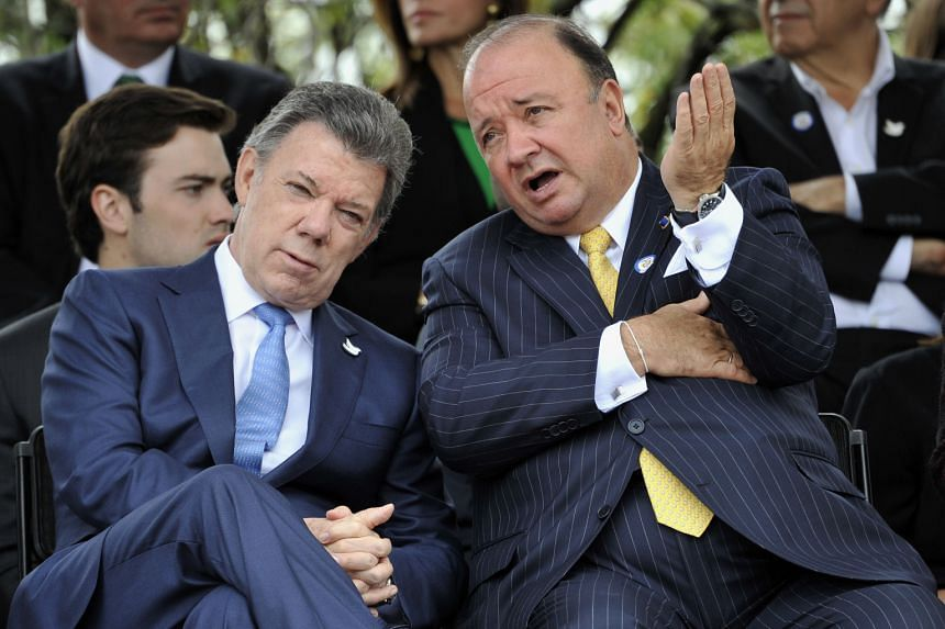 Colombian President Juan Manuel Santos (left) and Defence Minister Luis Carlos Villegas during a military parade held to celebrate the country's 205th Anniversary of Independence, in Bogota on July 20, 2015.