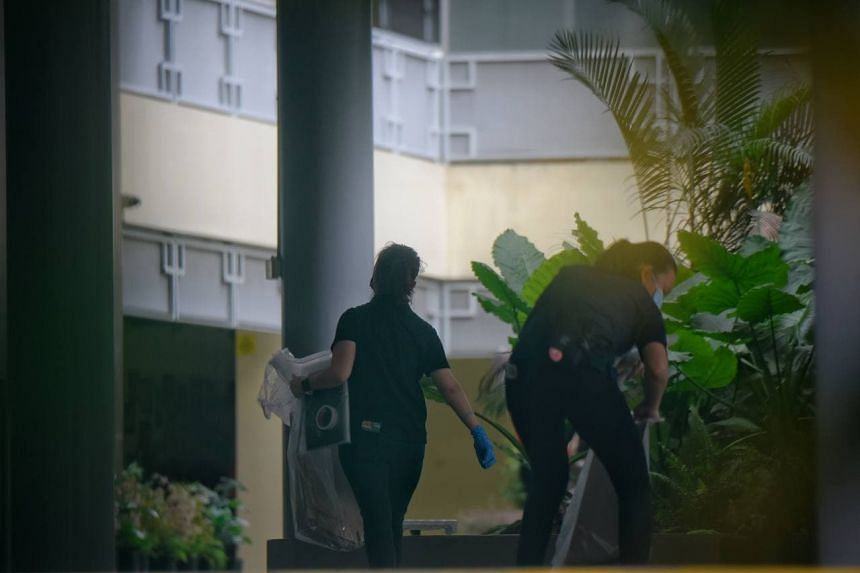 Police personnel with boxes to gather evidence at River Valley High School on July 19, 2021.