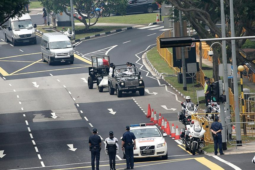 The procession carrying the body of the late former president S R Nathan arriving at the University Cultural Centre on Aug 26, 2016.