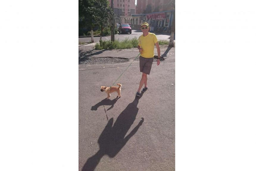 Mr Dion Leonard with his dog Gobi on a walk after being reunited.
