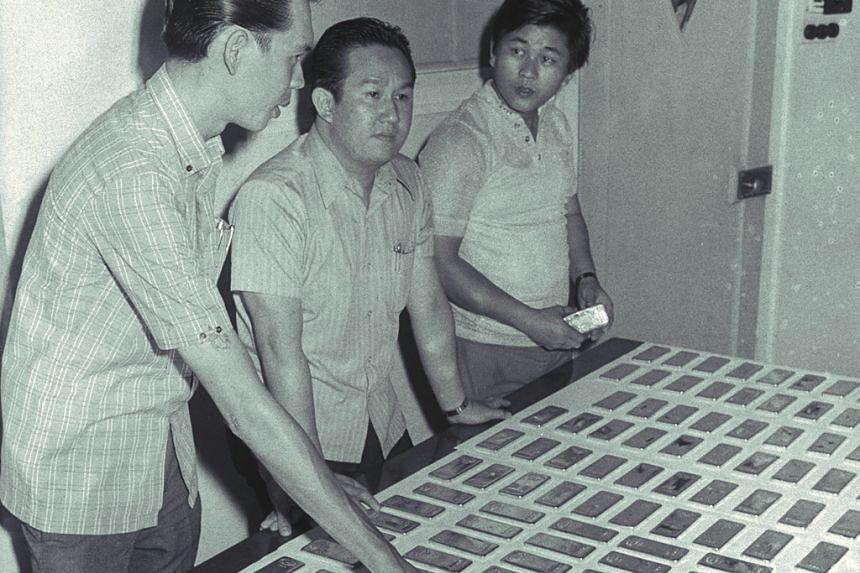 Criminal Investigation Department officers inspecting the recovered gold bars.