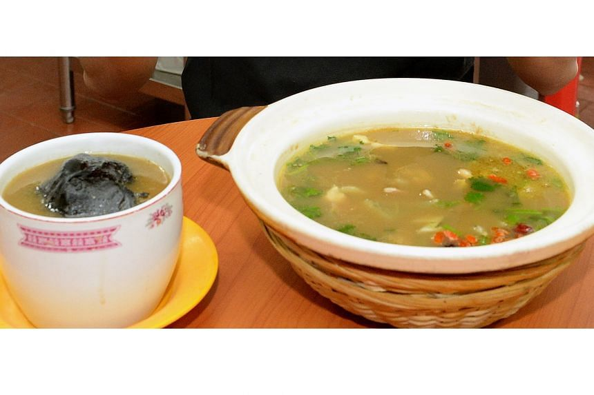 What he ate: Claypot turtle soup (right) that cost $65 and black chicken soup that cost $13.