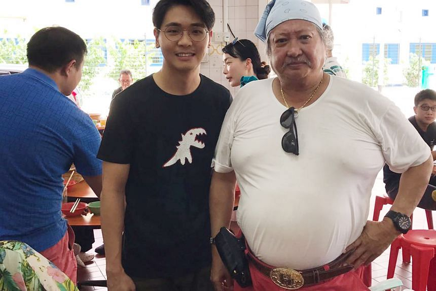 Hong Kong action star Sammo Hung with restaurant owner Chen Chonglu. Hung was in Geylang on Friday afternoon for some local dishes.