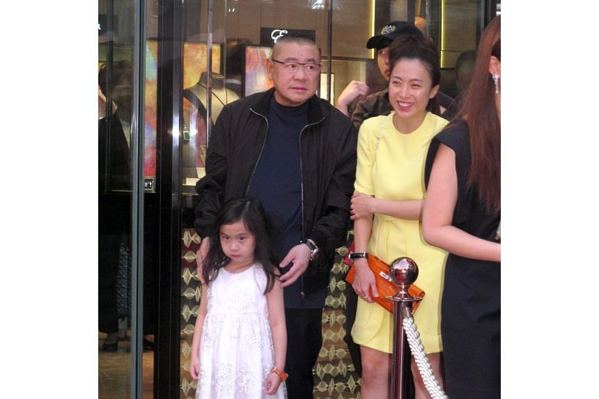 Property tycoon Joseph Lau (centre) with girlfriend Chan Hoi Wan and their daughter Josephine in Hong Kong in 2014.
