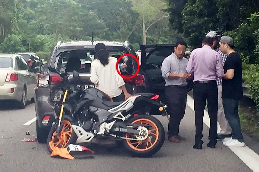 The motorcyclist was thrown from his motorbike through the broken window of the car in front, said an eyewitness.