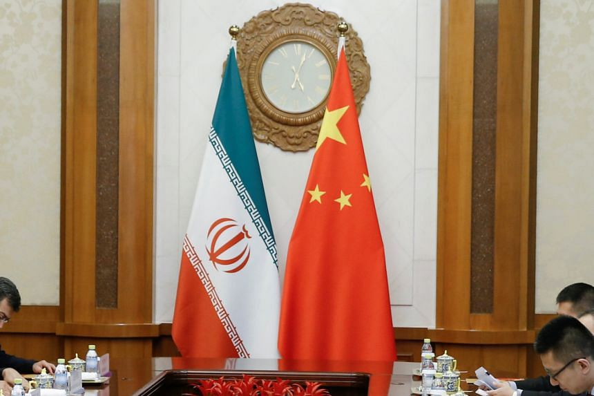 China has defended its commercial relations with Iran as open and transparent.