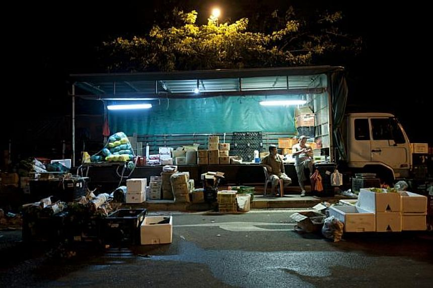 At night, trucks drive into a little street in Lorong 7 Toa Payoh, transforming the area into a makeshift vegetable wholesale centre.