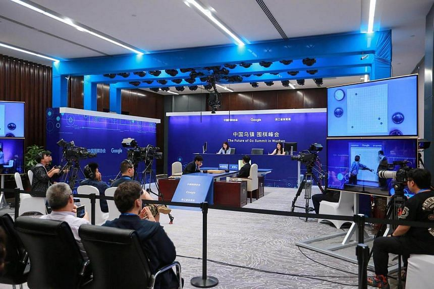 A general view shows China's 19-year-old Go player Ke Jie (centre, left) competing during the second match against Google's artificial intelligence programme AlphaGo, on May 25, 2017.