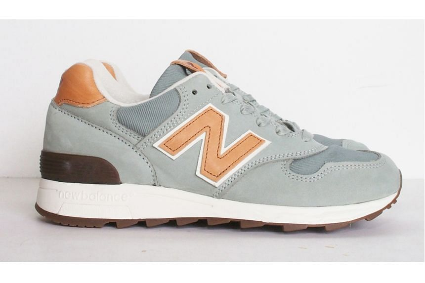 Unisex grey suede and leather sneaker with orange details, $349, New Balance, from Leftfoot.