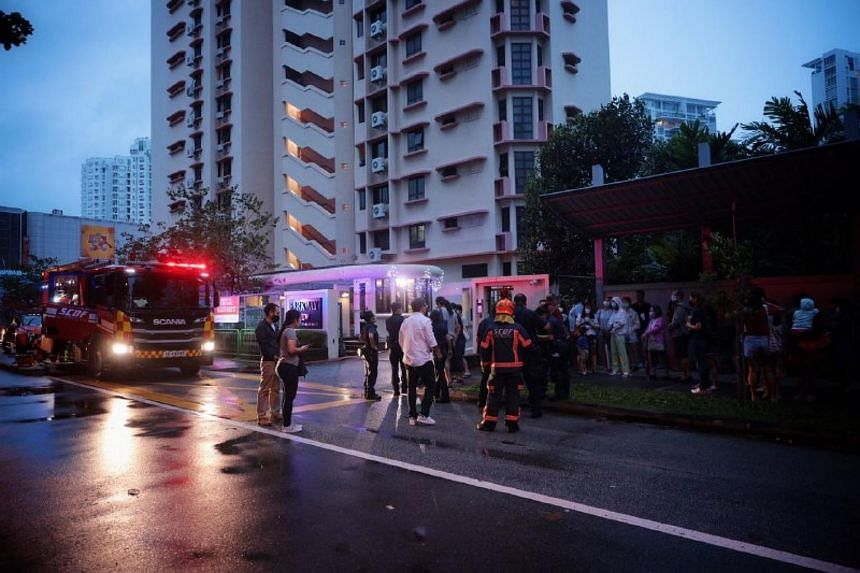 Residents evacuated outside the condominium at 39 Marine Parade Road, following a fire.