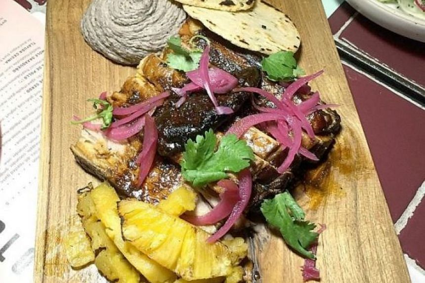 The Cerdo ($32) did not impress. The pork belly is cooked overnight with chillies, onions, vegetables, but arrived on the plate uneven. Some parts were too dry. But the black bean hummus saved it from being forgettable.