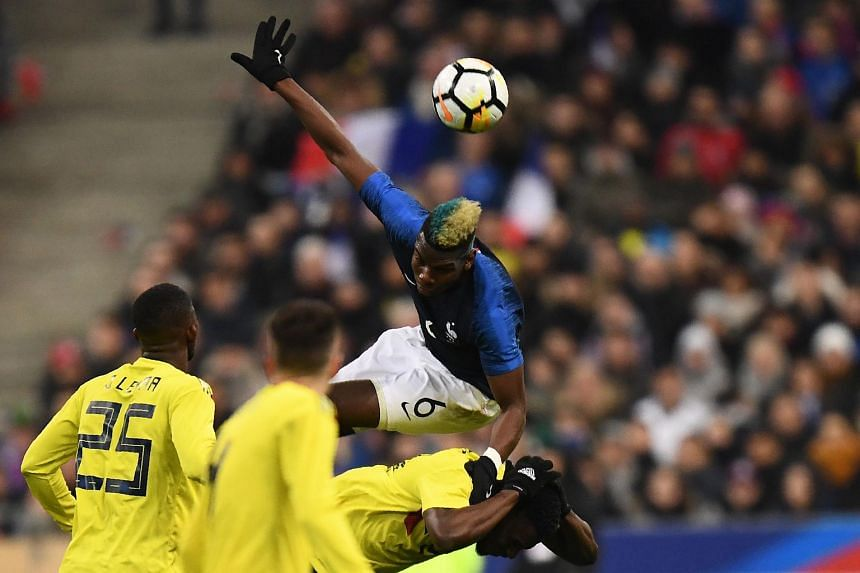 France's midfielder Paul Pogba heads the ball during the friendly football match between France and Colombia at the Stade de France, in Saint-Denis, on the outskirts of Paris, on March 23, 2018.