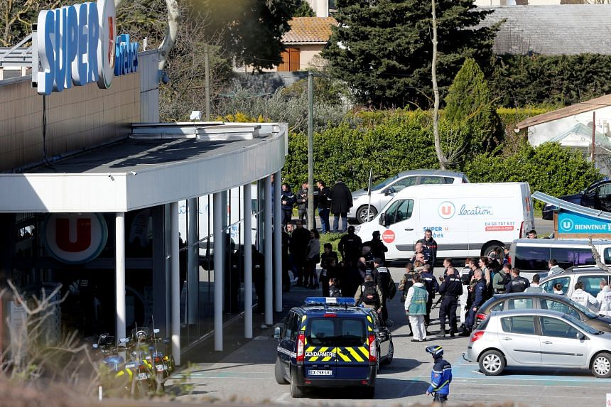 Gendarmes and police officers at a supermarket after a hostage situation in Trebes, France, on March 23, 2018.