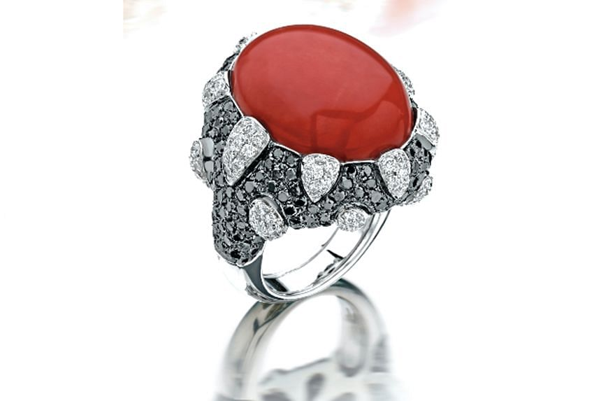 Italy: Ring with coral, white diamonds and black diamonds in 18K white gold, price unavailable, Oro Trend.