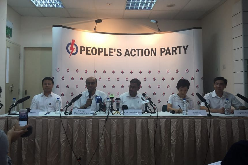 Lawyer Murali Pillai (centre) is the People's Action Party (PAP) candidate to defend Bukit Batok constituency at the by-election.