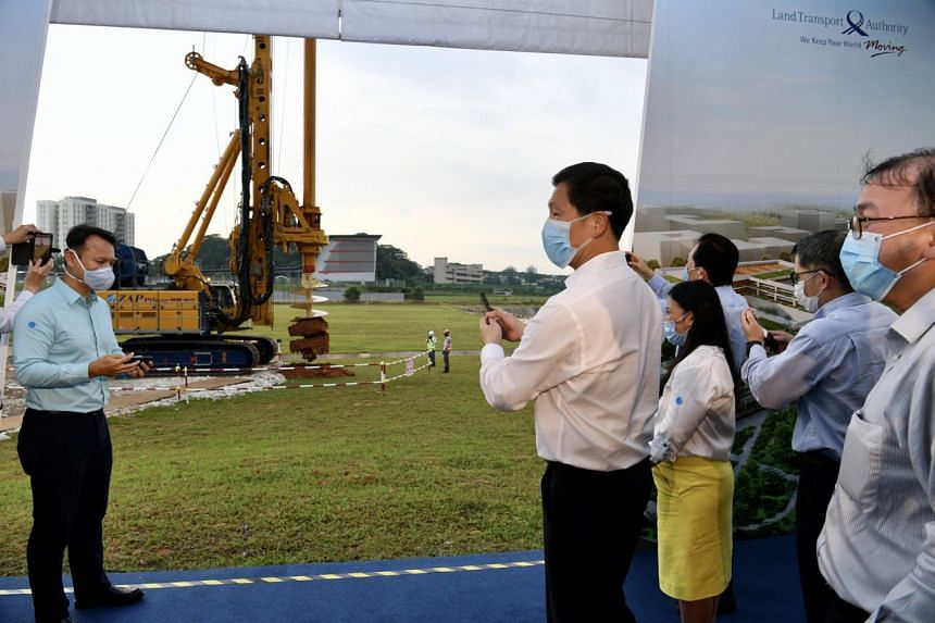Transport Minister Ong Ye Kung observing a rotary drilling rig in action during the ground-breaking ceremony.