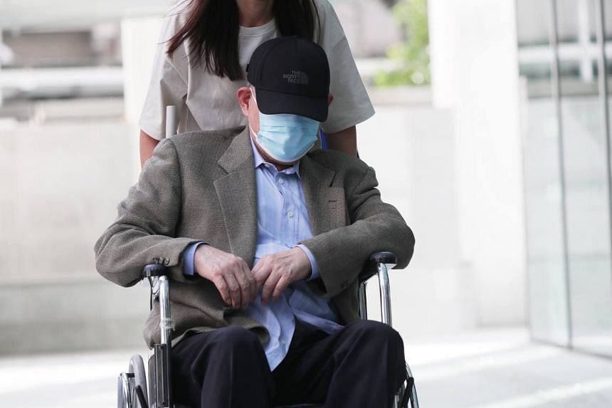 O.K. Lim arriving at the State Courts, on June 24, 2021. He  is now facing a total of 130 charges.