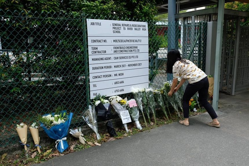 Flowers placed outside River Valley High School, on July 20, 2021.