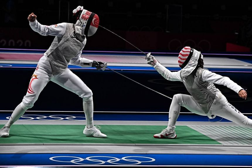 Amita Berthier (left) during her bout with Lee Kiefer in the women's individual foil event in Japan, on July 25, 2021.