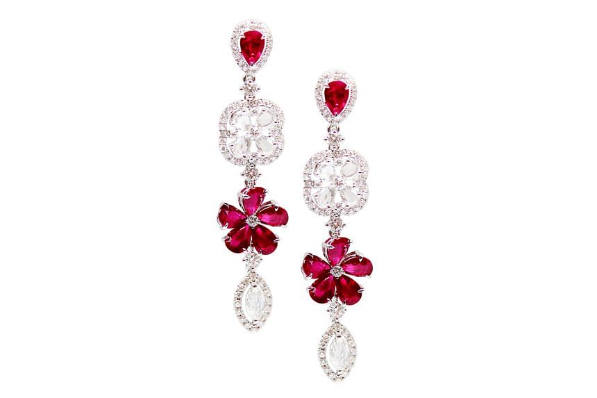 Pigeon blood ruby and diamond earrings, price unavailable, by Hong Kong brand Malpani.