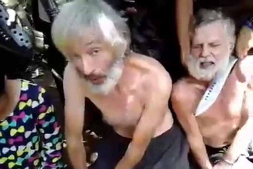 Canadian Robert Hall (centre), 50, pleading for his life in a video released by Abu Sayyaf. Beside him is fellow Canadian John Ridsdell, 68.