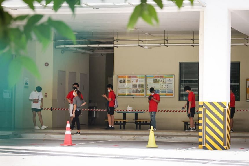 Dozens of students, teachers, staff and vendors were seen queuing up in the school at around 1pm on May 2, 2021, to get their swab test.