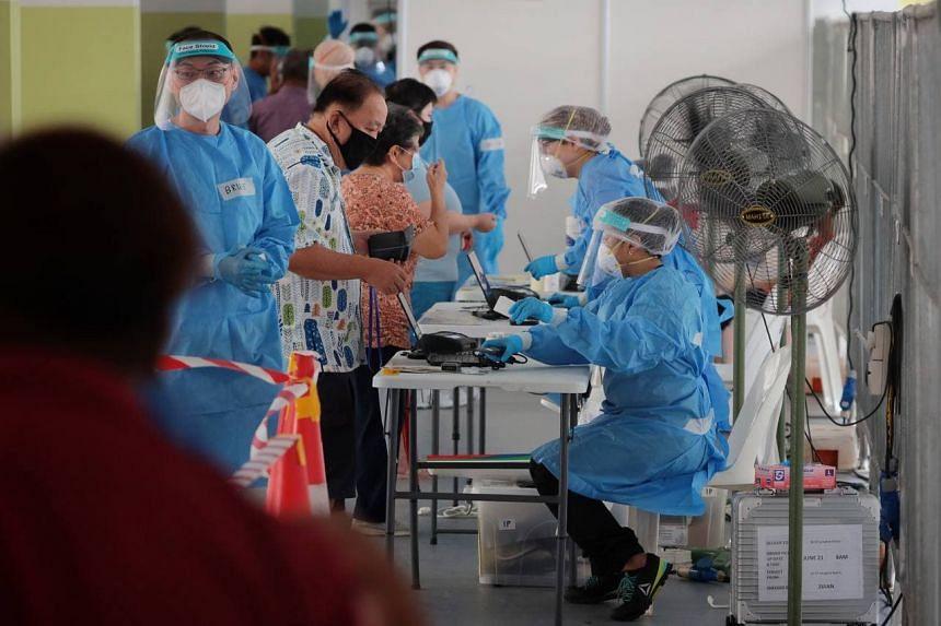 Residents going for their mandatory Covid-19 test at 53 Lengkok Bahru on June 28, 2021.