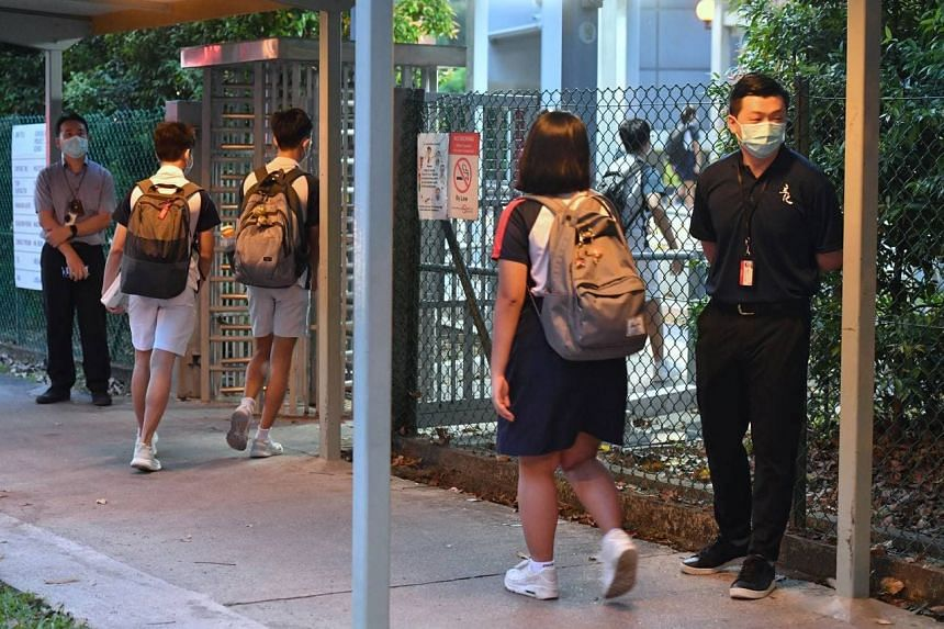More than a dozen school staff and security officers stood at the gates to usher in students as early as 6.30am.