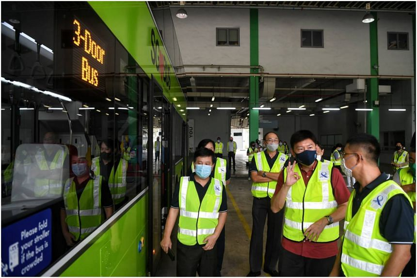 Senior Minister of State for Foreign Affairs and Transport, Mr Chee Hong Tat views the new buses at Bulim Bus Depot on Jan 11, 2021.