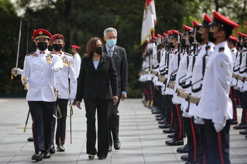Prime Minister Lee Hsien Loong and US Vice-President Kamala Harris inspecting the guard of honour at the Istana on Aug 23, 2021.