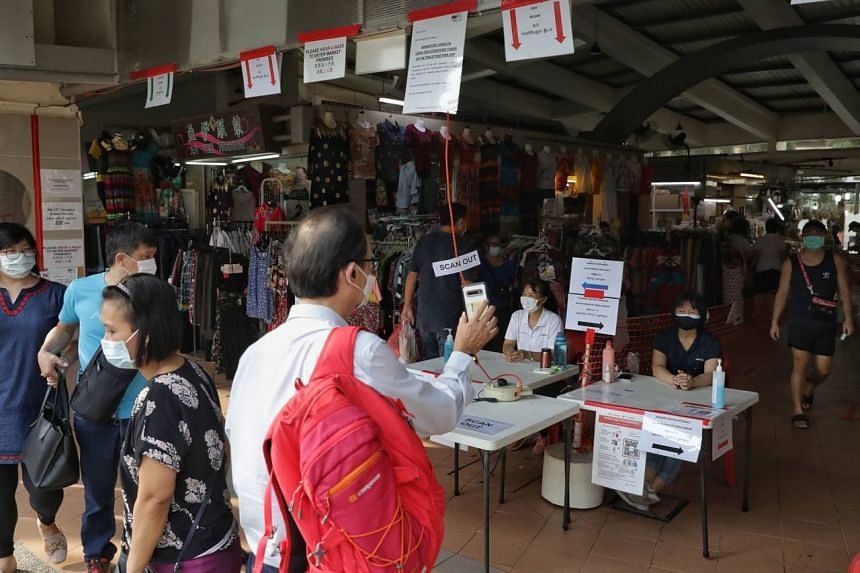 People showing their vaccination status before entering Tampines Round Market and Food Centre on Oct 13, 2021.