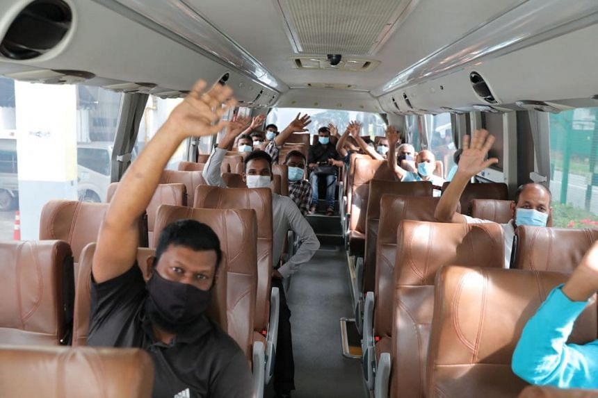 Migrant workers on a bus from Westlite Mandai Dormitory taking them to Little India on Sept 15, 2021.