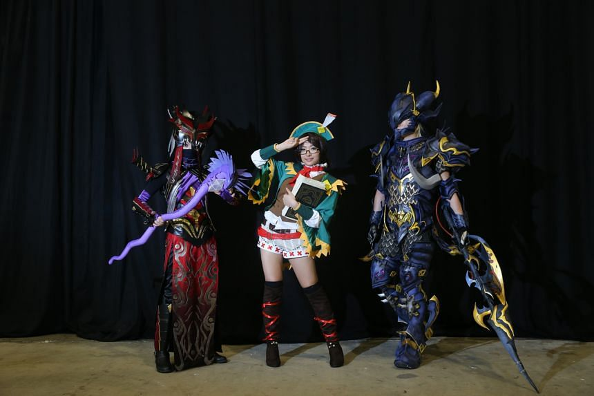 Ms Evelia Tan (centre) won the CosStage cosplay competition dressed as Guildmarm from the video game Monster Hunt 4. With her are second-place winner Leila Rhoda Tan (left) and third-place winner Chen Zong Ren (right).